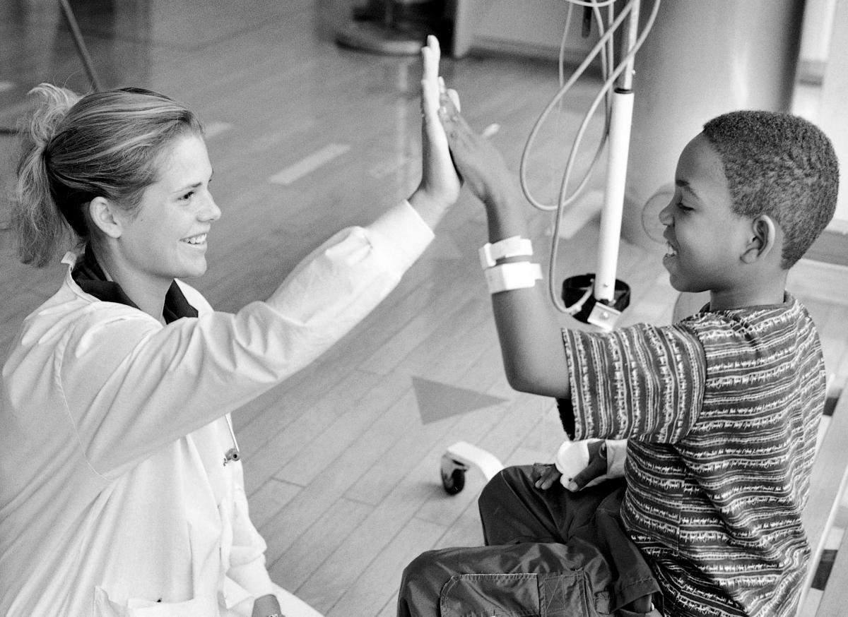 A nursing student and pediatric patient. A healing touch can take many forms --including a happy high five.	Eleanor Crowder Bjoring Center for Nursing Historical Inquiry, University of Virginia School of Nursing.