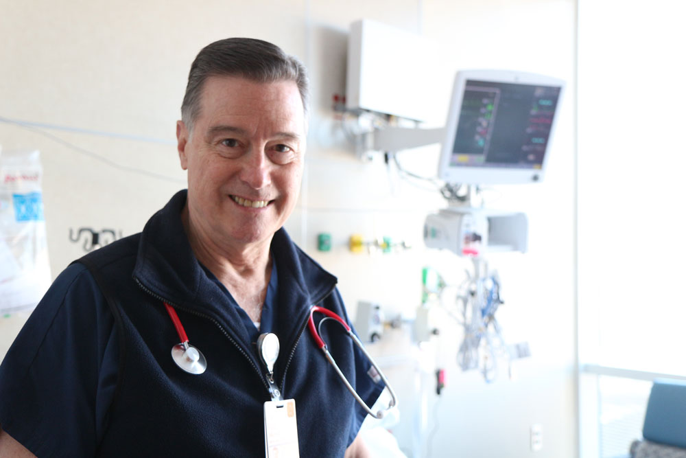 CNS Paul Merrel in a hospital room at UVA Health. Merrel, an alumnus and preceptor, ensured that his student mentees got the clinical hours they needed during COVID.