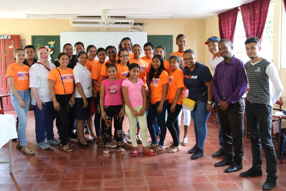 Simulation Squad students and faculty pose in classroom in Bluefields, Nicaragua