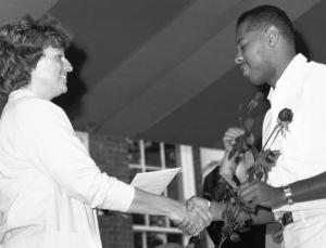1987 pinning.	JoAnne H. Peach, MSN, President of the University of Virginia School of Nursing Alumni Council with graduating student. Eleanor Crowder Bjoring Center for Nursing Historical Inquiry, University of Virginia School of Nursing.