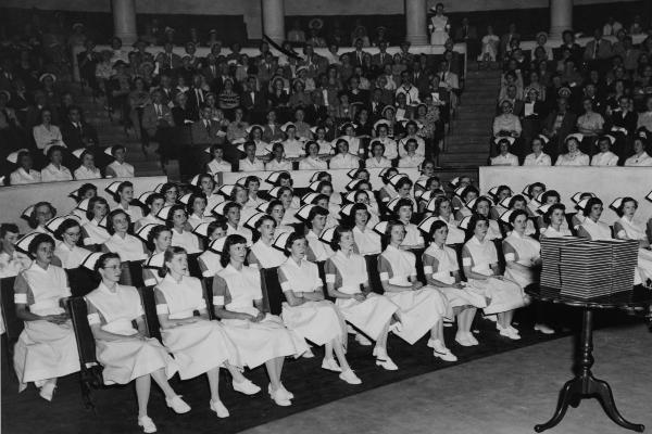 1951 graduates wear the white shoes and hose now permitted during the last six months of training.	Lorraine Bowers Albrecht (DIPLO 1951) donation to the ECBCNHI. Eleanor Crowder Bjoring Center for Nursing Historical Inquiry, University of Virginia School of Nursing.