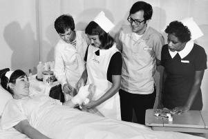 Student nurses' uniforms of the 1970s.	School of Nursing Catalog, The Record, 1978-79.
