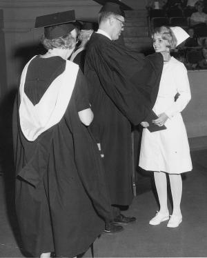 A 1966 diploma graduate proudly receives her School of Nursing pin.	Eleanor Crowder Bjoring Center for Nursing Historical Inquiry, University of Virginia School of Nursing.