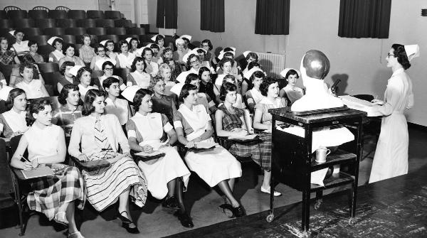 Vivian White instructs a 1954 class in McKim Hall auditorium.	Eleanor Crowder Bjoring Center for Nursing Historical Inquiry, University of Virginia School of Nursing.