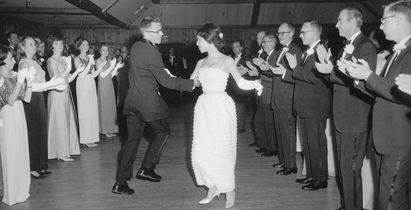 School of Medicine Dean Kenneth Crispell swings his nursing student partner at the senior dance, in the traditional Virginia Reel.	Eleanor Crowder Bjoring Center for Nursing Historical Inquiry, University of Virginia School of Nursing. Ralph Thompson, Photographer.