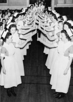 Banding, an important rite of passage for second-year students, was celebrated with a candlelit procession and ceremony.	Ruth Repass Shaver Collection.   Eleanor Crowder Bjoring Center for Nursing Historical Inquiry, University of Virginia School of Nursing.