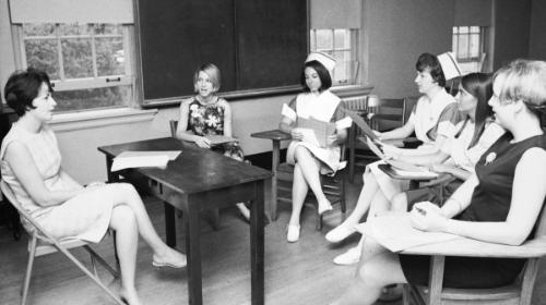 Faculty member and students in McKim basement classroom discussion, c. 1967.	Eleanor Crowder Bjoring Center for Nursing Historical Inquiry, University of Virginia School of Nursing.