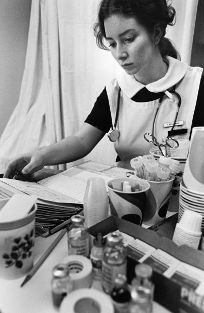 An undergraduate student prepares medications.	Casey Weissenborn (later Finn), BSN 1976.