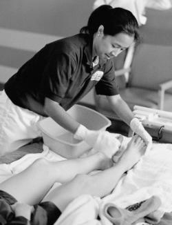 A student nurse washing a patient's feet. The gentle human touch remains a vital part of nursing.	Eleanor Crowder Bjoring Center for Nursing Historical Inquiry, University of Virginia School of Nursing.