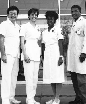 By the 1980s nursing students no longer wore standardized uniforms, but were identified by orange and blue arm patches.	Eleanor Crowder Bjoring Center for Nursing Historical Inquiry, University of Virginia School of Nursing. Ralph Thompson, Photographer.