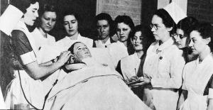 Roy Beazley instructs students in clinical care using 'Mrs. Chase', the first patient simulator. Ruth Repass Shaver Collection.   Eleanor Crowder Bjoring Center for Nursing Historical Inquiry, University of Virginia School of Nursing.